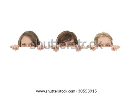 Three young women behind a blank banner ad, on white background. - stock photo
