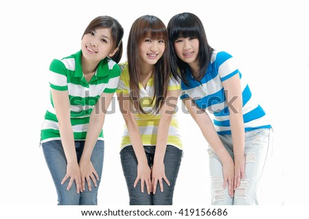 Three young women having a good time chatting and laughing