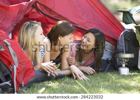 Three Young Women On Camping Holiday Together