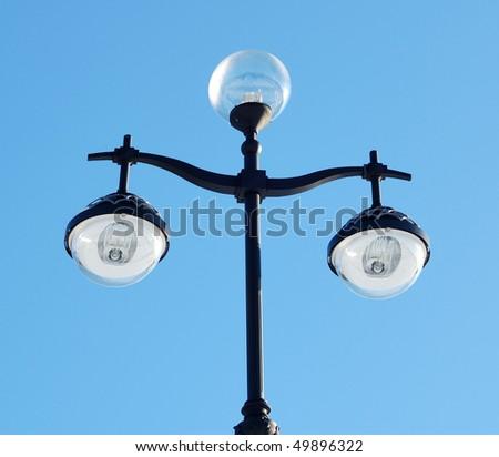Threefold lantern isolated on the blue background - stock photo