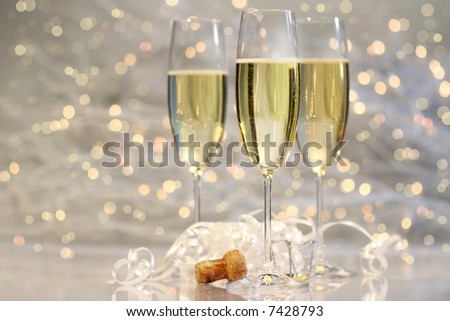 Threes glasses of champagne with silver background - stock photo