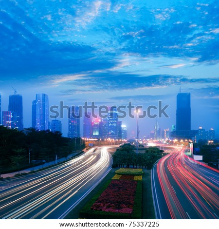Through the city's roads and slow shutter running car - stock photo