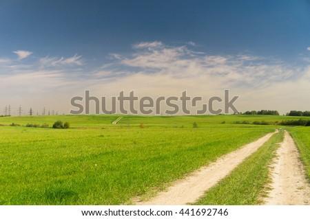 Through the Green Fields of Sunlight  - stock photo