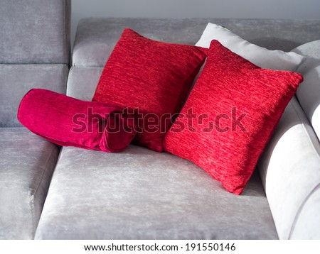Throw pillows on couch isolated on white - stock photo