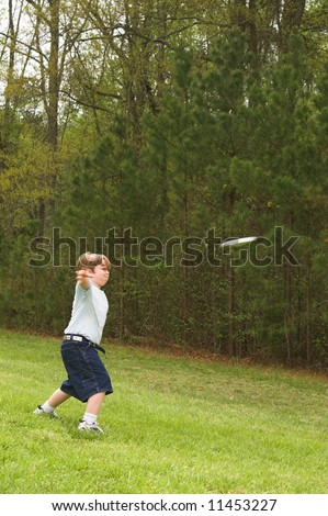 Throwing a Frisbee - stock photo