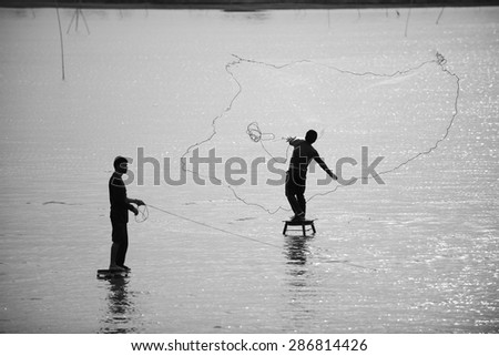 Throwing fishing net , Thailand - stock photo