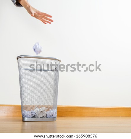 Throwing of paper ball - stock photo
