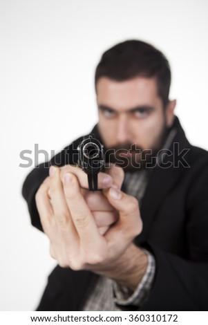 Thug with a Gun - stock photo