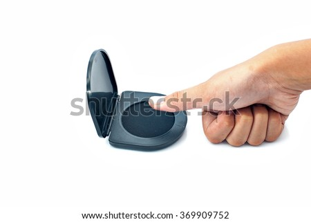 Thumb getting ready to use thumb print ink pad on white background. - stock photo