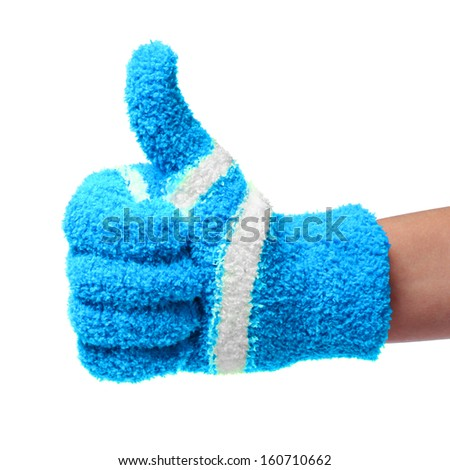 Thumb up. hand in knitted blue gloves isolated on white background