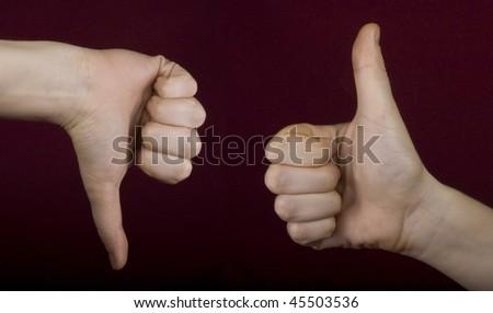 thumb up, thumb down - stock photo