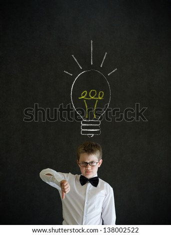 Thumbs down boy dressed up as business man with bright idea chalk background lightbulb on blackboard background - stock photo
