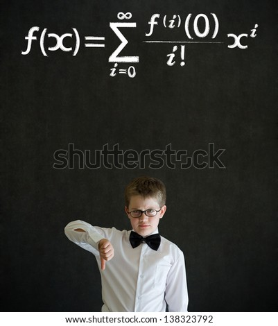 Thumbs down boy dressed up as business man with maths equation on blackboard background - stock photo