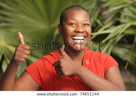 Thumbs up and a smile - stock photo