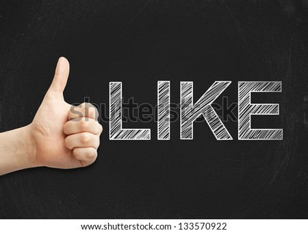 thumbs up and like drawing on desk - stock photo