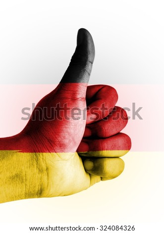 Thumbs up digitally compositing on with Germany flag - stock photo