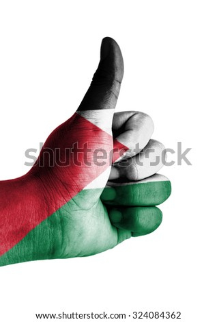 Thumbs up digitally compositing on with Palestine flag - stock photo