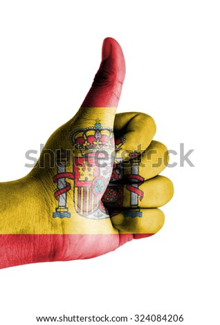 Thumbs up digitally compositing on with Spain flag - stock photo