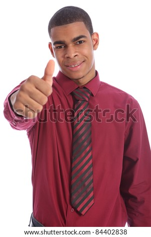 Thumbs up for success from Smartly dressed good looking young African American man with happy smile on his handsome face. Wearing red shirt and necktie. - stock photo