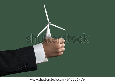 Thumbs up for the green Energy - stock photo