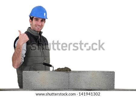 Thumbs up from a bricklayer - stock photo