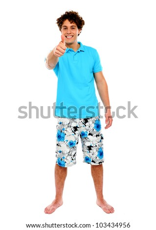 Thumbs-up from a casual guy. Isolated over white - stock photo