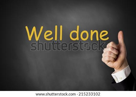 thumbs up gesture black chalkboard praise - stock photo