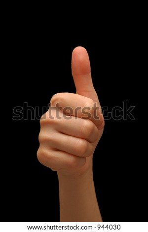 Thumbs up hand signal, isolated with a black background