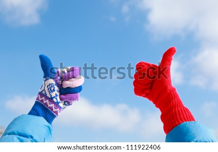 thumbs up on winter snow - stock photo