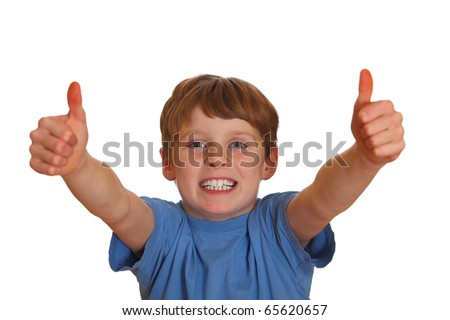 Thumbs up shown by a happy young boy - stock photo