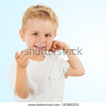 Thumbs up! Smiling happy cute boy, studio shot, isolated on white - stock photo