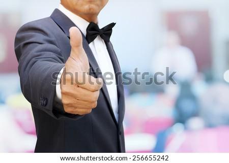 thumbs up team seminar - stock photo