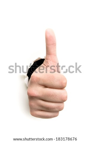 Thumbs up through the paper hole isolated on white background - stock photo