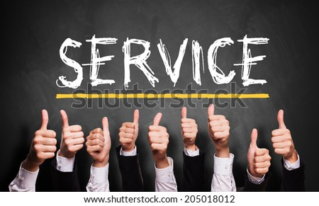 thumbs up to good service - stock photo