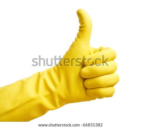 Thumbs up with a yellow vinyl glove - stock photo