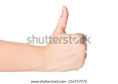 thumbs up with plaster bandage isolated on white background. - stock photo