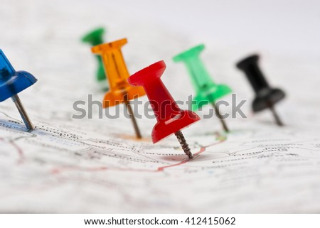 Thumbtack in a Road Map with a Selective Focus - stock photo