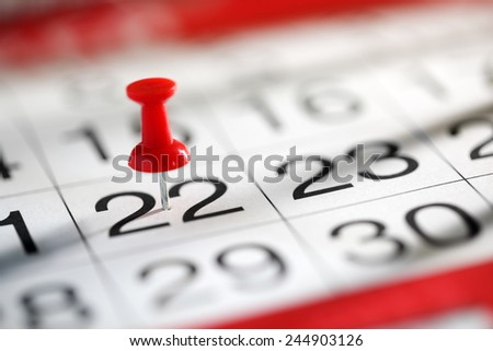 Thumbtack in calendar concept for important date or busy day - stock photo