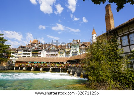 THUN, SWITZERLAND - SEPTEMBER 08, 2015: General view towards the Old Town of Thun. Thun with a population of approx. 45,000 citizens it is a city located in the canton of Bern, on the River Aare - stock photo