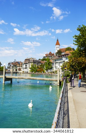 THUN, SWITZERLAND - SEPTEMBER 08, 2015: River Aare and the Town of Thun. Thun with a population of approx. 45000 citizens it is a city located in the canton of Bern, situated on the River Aare - stock photo