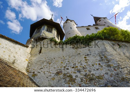 THUN, SWITZERLAND - SEPTEMBER 08, 2015: The famous Castle towering over the hill. The castle was built in the 12th century, nowadays it houses the Thun Castle museum - stock photo