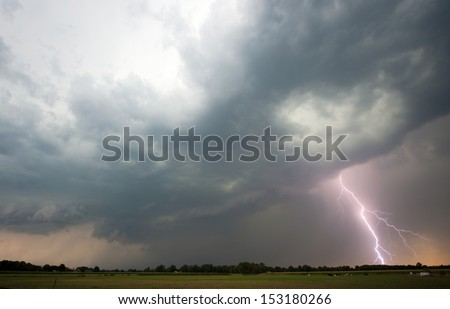 Thunder and lightning at the end of a hot and moistly day in the Netherlands - stock photo