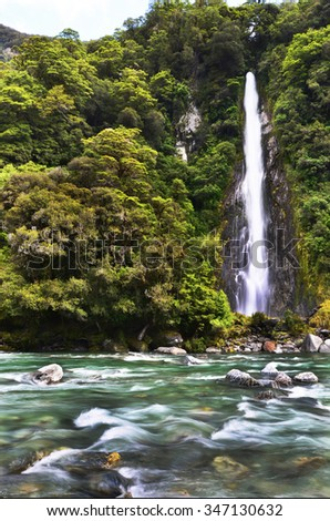 Thunder creek fall in tropical forest of New Zealand - stock photo