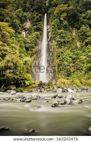 Thunder Creek falls in Haast Pass on the Southern Alps on South island of New Zealand - stock photo