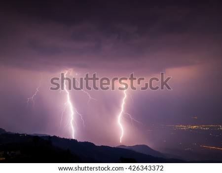 Thunder storm on mountain.Lightning with heavy rain.Thunder storm and lightning on nigh time. This image taking on night by long exposure among storm on the top of mountain. - stock photo