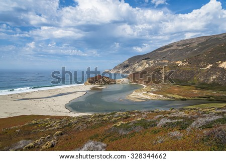 Thunder storms, waves splashing on huge rocks, off shore, along a rocky coastline, at the inlet to the Little Sur River, traveling the Big Sur Highway (Highway 1), on the California Central Coast. - stock photo