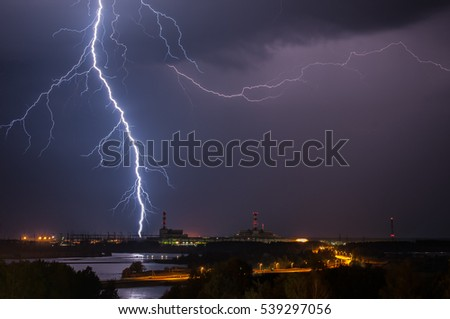 Thunderstorm above power plant
