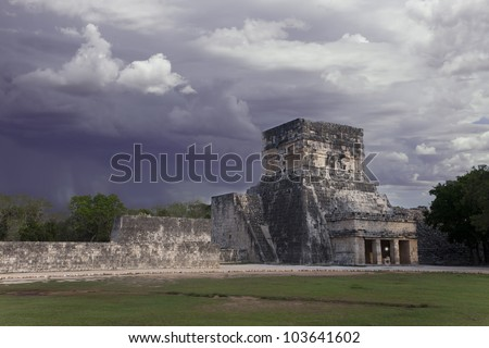 thunderstorm and sun under mayan ruins Chichen Itza Mexico - stock photo