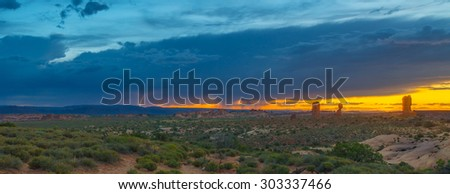 Thunderstorm approaches Arches National Park, UT - stock photo