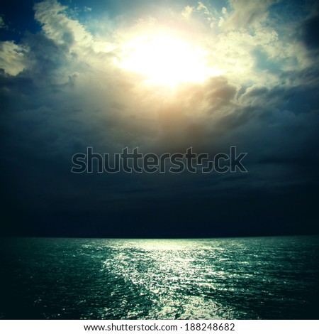 Thunderstorm in the Sea with Dramatic Clouds - stock photo